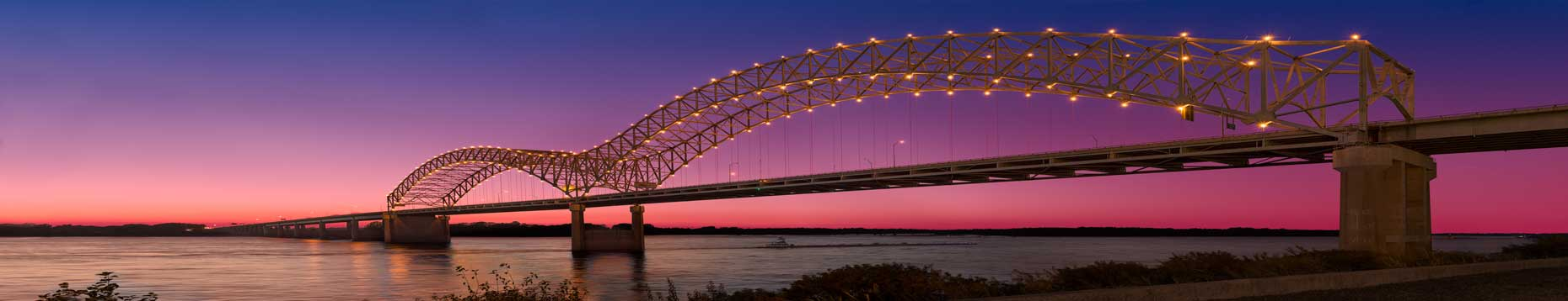 Exterior twilight view of the Memphis (Hernando de Soto) Bridge