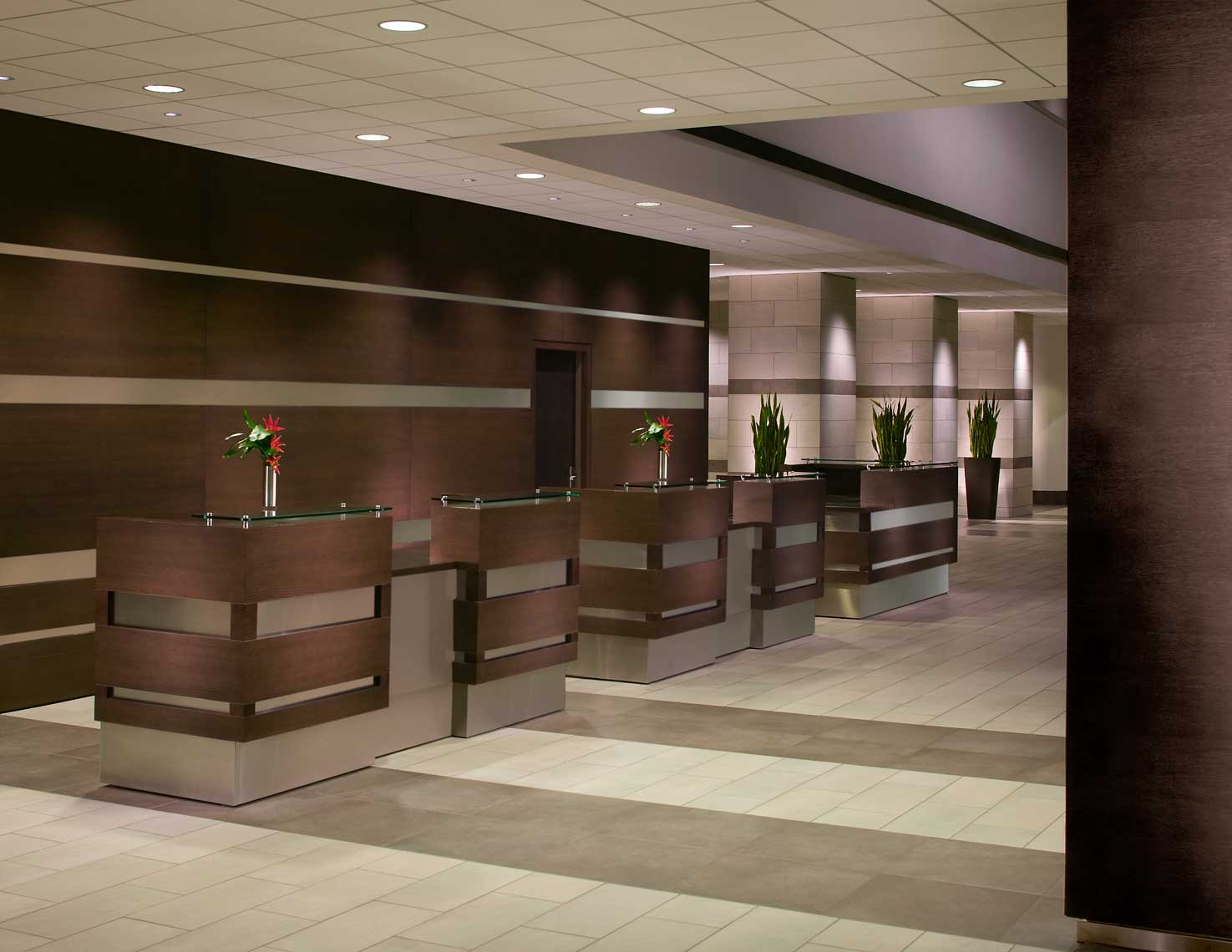 A sleek and inviting view of the reception desk at the Hyatt Regency Indianapolis