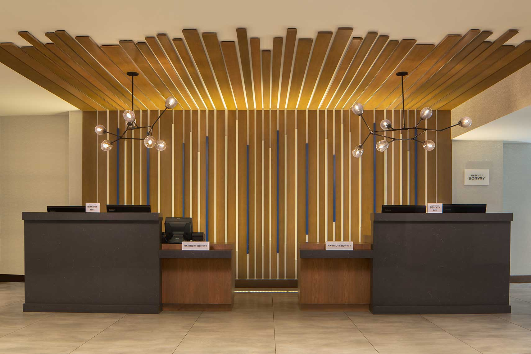 A head-on view of the striking front desk at the Marriott Atlanta Perimeter Center