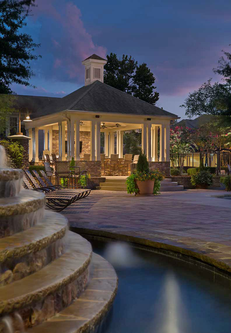 A twilight view across the fountain highlights the pool pavilion at The Reserve at Sugarloaf