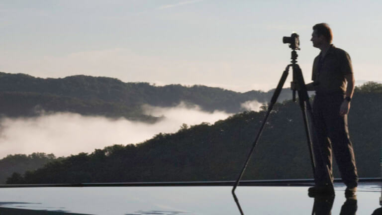 A portrait of architectural photographer Rion Rizzo photographing on location in the Smoky Mountains