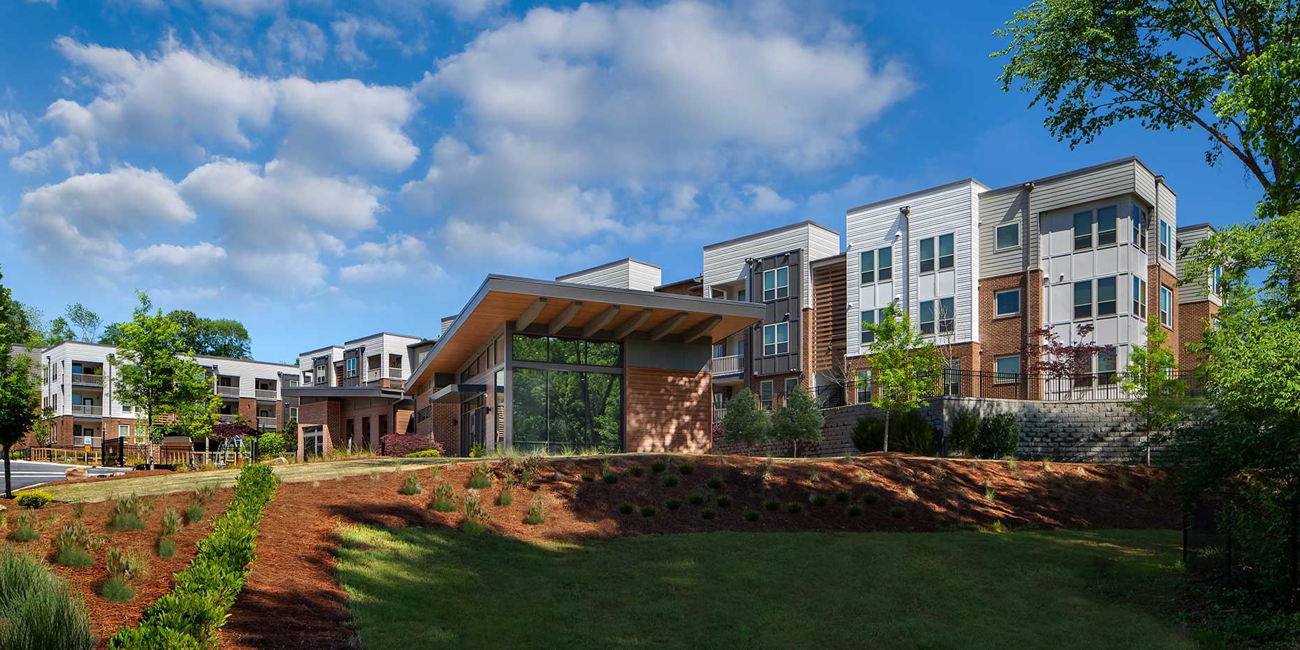 A pastoral setting surrounds the buildings of the Gardenside at Villages of East Lake