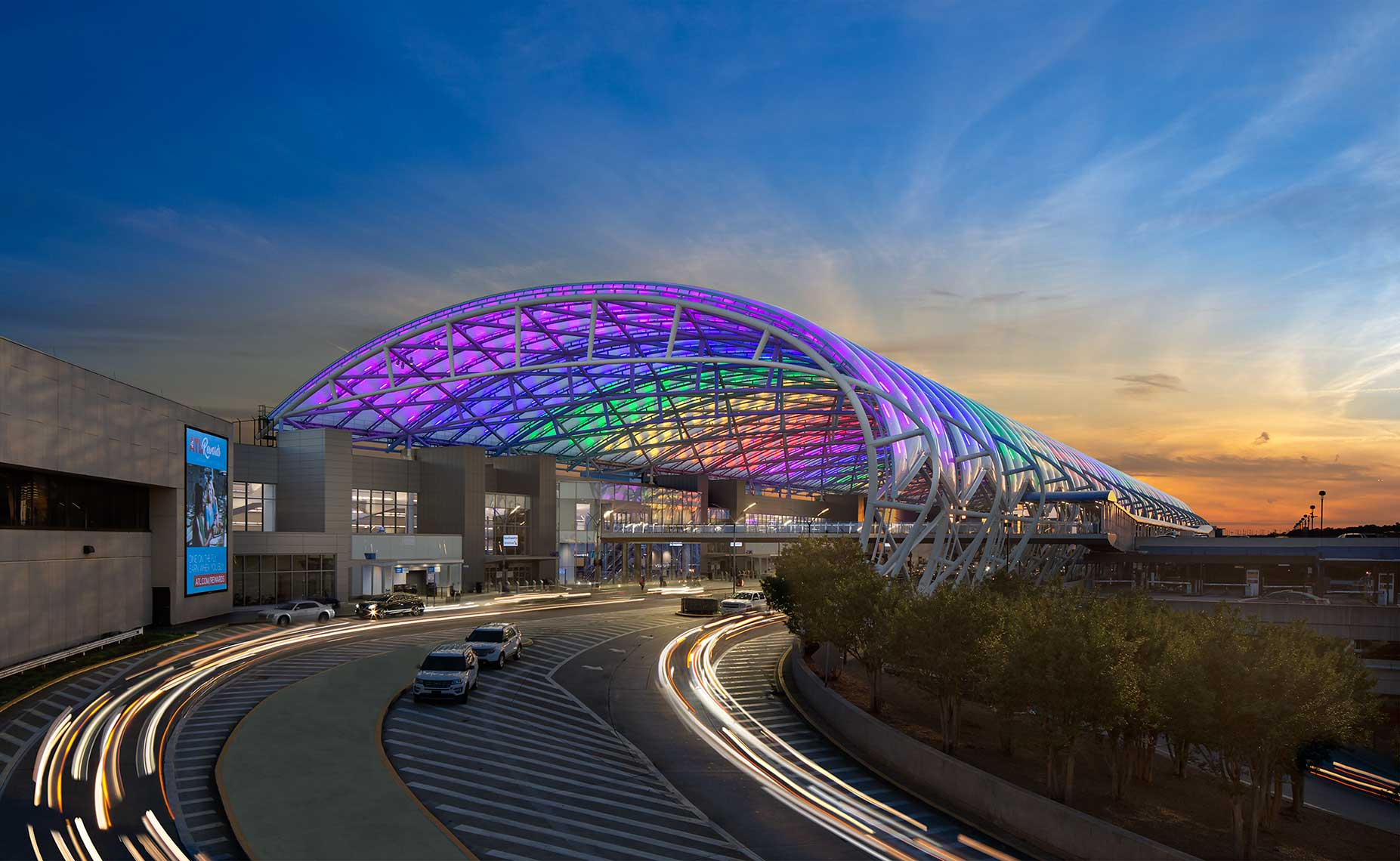 The canopy glows in a rainbow of colors at dusk at Hartsfield Jackson Atlanta International Airport